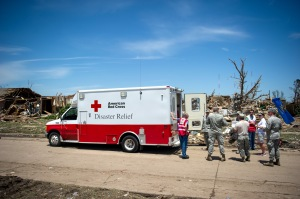 May 22, 2013. Moore, Oklahoma. Soldiers from Tinker Air Force Base take a much needed break from cleaning up tornado debris to enjoy meals from the Red Cross.
