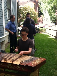 Reylon Yount plays on his Chinese dulcimer, rescued by firefighters from a burning apartment building one June 5.