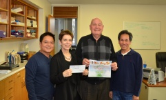 Members of Nhom Huong Thien present a check at the Northeastern chapter
