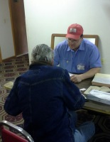 Mark Holden chats with a resident affected by fire
